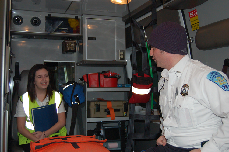 ASM's Sean Norton shows Corrine the inside of the ambulance