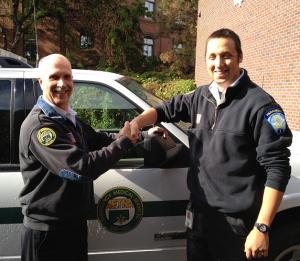 Director of Operations Graham MacDonald congratulates Kyle Goulet